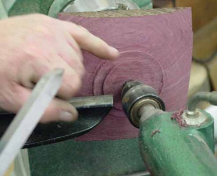 Bottom of Purple Heart square bowl with tennon left for turning top. Note the beading tool which has been ground as a 'ngeative rake' scraper