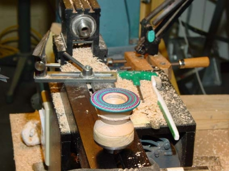 The spinning-top bottom has been threaded and decorated but is still left on the face plate