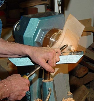 The lid is jammed onto the the base in order to shape the top surface and knob.