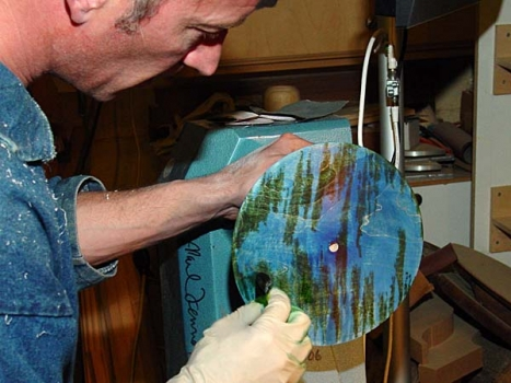 Staining the finished top surface with blue, green and yellow analine dyes in alcohol carrier.