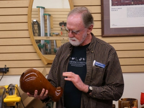 Sam T. and Jim R. critique Tom B's vase