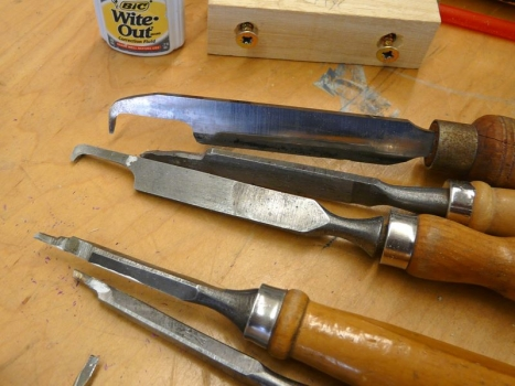 Various scrapers.  Whiteout is used to mark tools for accurate depth of cut