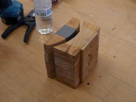 Clamping blocks to bend microwave softened wood insert