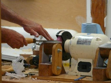 Grinding a scraper