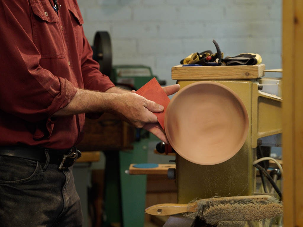 Hand sanding for creating concentric sanding pattern for final finish