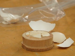 Glue in the egg shell with wood glue