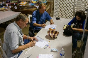 Kevin Wallace judging the entries -  Mark and Linda E. keeping the records