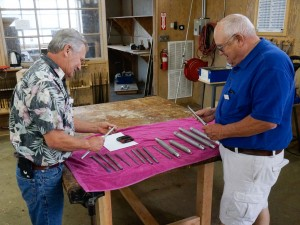 John A. examines Bruce O.'s tools for sale