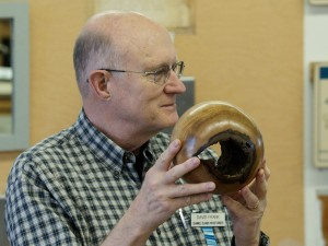 David turned a hollow log into a sphere