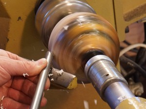 Scraping with the top wing of the gouge