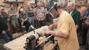Joe R. turning a bowl for large audience