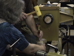 Joanne helps with splitting the paper joints. Art says align chisel flat side with the good wood.