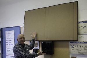 """Dave S. with mockup of 75"""" TV for the proposed AV upgrade"""