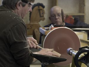 Shaping blade on variable speed MDF sanding disk